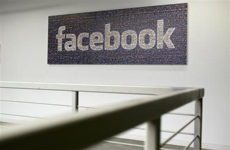 The Facebook logo is pictured in the Facebook headquarters in Menlo Park.
