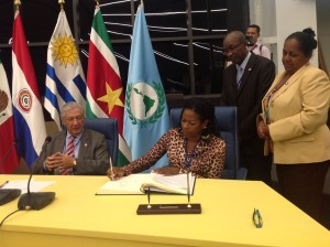 Signing at Parlatino new Headquarters President Arrindell signs guestbook