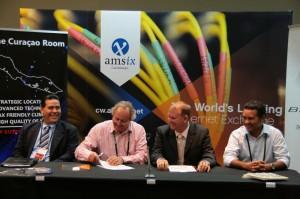 Signing connection agreement Flamingo TV - AMS-IX Caribbean