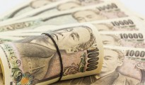 Close up Japanese Yen banknotes on white background.