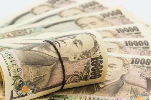 Close up Japanese Yen banknotes on white background.