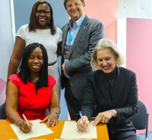 Elgenia Pieternella and EBAN Chairman Candace  Johnson signing