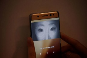 A model demonstrates iris recognition function of Galaxy Note 7 new smartphone during its launching ceremony in Seoul