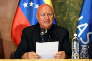 Vatican's representative Claudio Maria Celli speaks during a meeting between government and opposition in Caracas