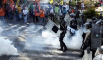 Opposition supporters clash with riot police during a rally against Venezuelan President Nicolas Maduro's government and to commemorate the 59th anniversary of the end of the dictatorship of Perez Jimenez in San Cristobal