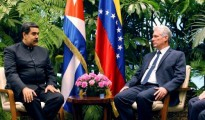 Cuban President Miguel Diaz-Canel speaks to Venezuela's President Nicolas Maduro at the Revolution Palace in Havana
